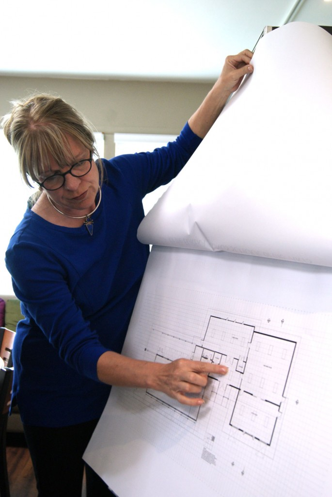 Peggy with blueprints